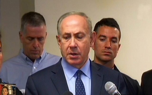 Prime Minister Benjamin Netanyahu addresses the media about raging wildfires on Thursday, November 24, 2016 (screen capture: Channel 2)