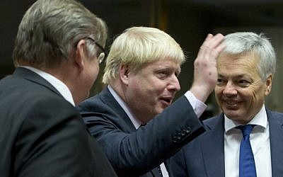 British Foreign Secretary Boris Johnson, center, speaks with Belgian Foreign Minister Didier Reynders, right, and Finnish Foreign Minister Timo Juhani Soini, left, during a meeting of EU foreign ministers at the EU Council building in Brussels on Monday, Nov. 14, 2016. (AP Photo/Virginia Mayo)