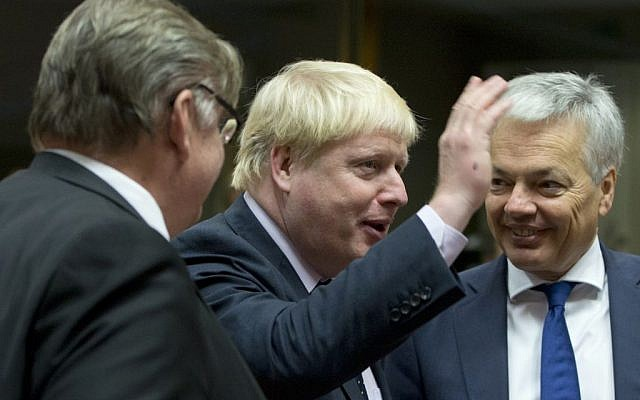 British Foreign Secretary Boris Johnson, center, speaks with Belgian Foreign Minister Didier Reynders, right, and Finnish Foreign Minister Timo Juhani Soini, during a meeting of EU foreign ministers at the EU Council building in Brussels on November 14, 2016. (AP Photo/Virginia Mayo)