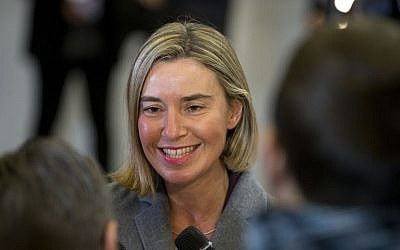 European Union High Representative Federica Mogherini speaks with the media as she arrives for a meeting of EU foreign ministers at the EU Council building in Brussels on Monday, Nov. 14, 2016. (AP Photo/Virginia Mayo)