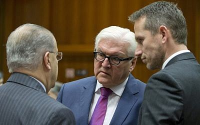 German Foreign Minister Frank-Walter Steinmeier, center, speaks with Cypriot Foreign Minister Ioannis Kasoulides, left, and Danish Foreign Minister Kristian Jensen, right, during a meeting of EU foreign ministers at the EU Council building in Brussels on Monday, Nov. 14, 2016. (AP Photo/Virginia Mayo)
