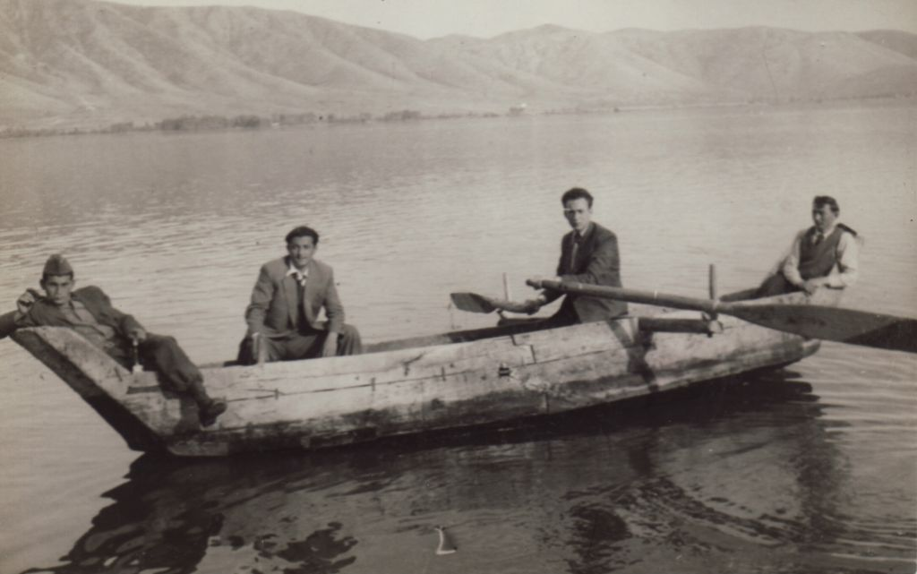 Beni Elias (holding oars) in a Kastorian boat in the early 1950s. (Screenshot)