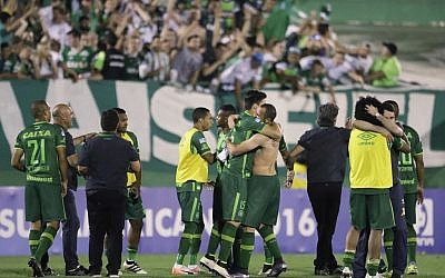 Players from Brazil's Chapecoense celebrate at the end of a Copa Sudamericana semifinal soccer match against Argentina's San Lorenzo in Chapeco, Brazil, Nov. 23, 2016. (AP Photo/Andre Penner)