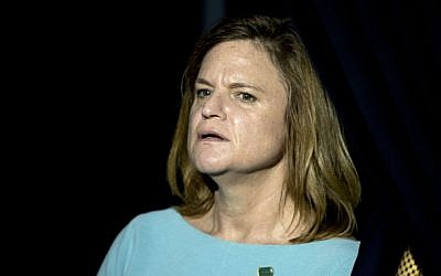 In this Oct. 30, 2016, file photo, Hillary Clinton campaign Director of Communications Jennifer Palmieri stands off-stage during a rally for the Democratic presidential candidate at The Manor Complex in Wilton Manors, Florida. (AP Photo/Andrew Harnik)