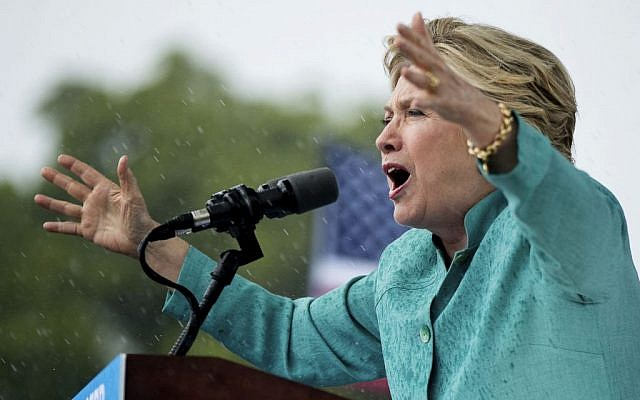 Democratic presidential candidate Hillary Clinton speaks during a heavy rain at a rally at C.B. Smith Park in Pembroke Pines, Fla., Saturday, Nov. 5, 2016. (AP Photo/Andrew Harnik)