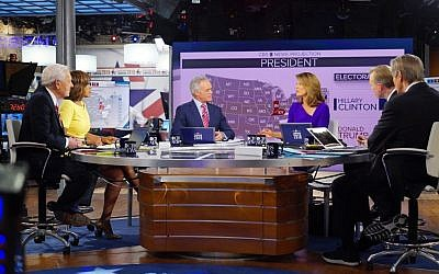 CBS News Contributor Bob Schieffer, from left, CBS This Morning co-host Gayle King, CBS Evening News anchor Scott Pelley, CBS This Morning co-host Norah O'Donnell, Face the Nation anchor John Dickerson and CBS This Morning co-host Charlie Rose host 2016 election night coverage on Nov. 8, 2016, at the CBS Broadcast Center in New York. (Michele Crowe/CBS via AP)