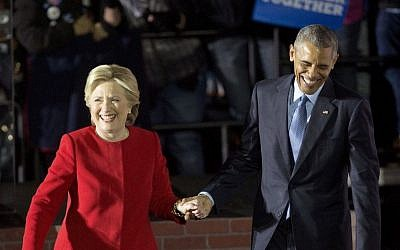 President Barack Obama and Democratic presidential candidate Hillary Clinton hold hands as they walk off stage after both spoke at a rally at Independence Mall in Philadelphia. Monday, November 7, 2016. (AP Photo/Pablo Martinez Monsivais)