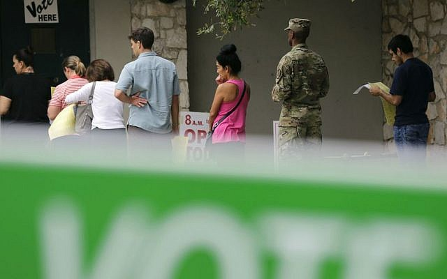 In this Nov. 4, 2016, photo, voters wait in line to cast ballots at an early polling site in San Antonio, Texas. (AP Photo/Eric Gay)