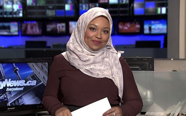 This image made from a video provided by CityNews shows Ginella Massa, a Toronto TV reporter who is believed to be Canada's first anchor to don a Muslim head scarf at one of the city's major news broadcasters. (CityNews via AP)