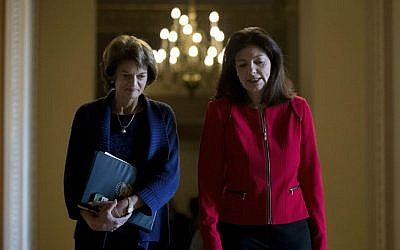 Sen. Lisa Murkowski, R-Alaska, left, and Sen. Kelly Ayotte, R-New Hampshire, leave a Senate Republican conference leadership election meeting on Capitol Hill in Washington, Wednesday, Nov. 16, 2016, after Senate Republicans re-elected Senate Majority Leader Mitch McConnell of Kentucky to be majority leader for the upcoming 115th Congress. (AP Photo/Andrew Harnik)