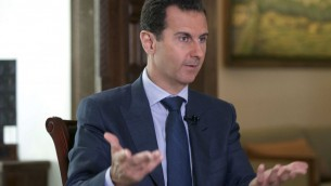 Syrian President Bashar Assad speaks at the presidential palace in Damascus, Syria, Sept. 21, 2016 (Syrian Presidency via AP)