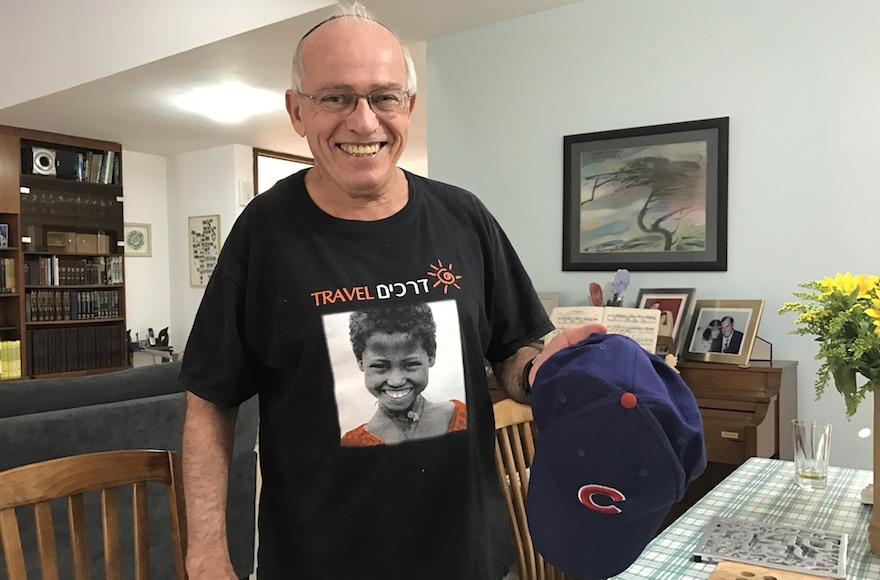 Michael Rich displaying his Chicago Cubs cap at his house in Karnei Shomron, Oct. 28, 2016. (JTA/Andrew Tobin)