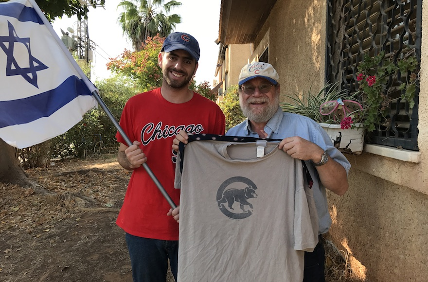 Harel Gold, left, and Rabbi Sidney Gold displaying their Cubs gear outside their home in Karnei Shomron, Oct. 28, 2016. (JTA/Andrew Tobin)