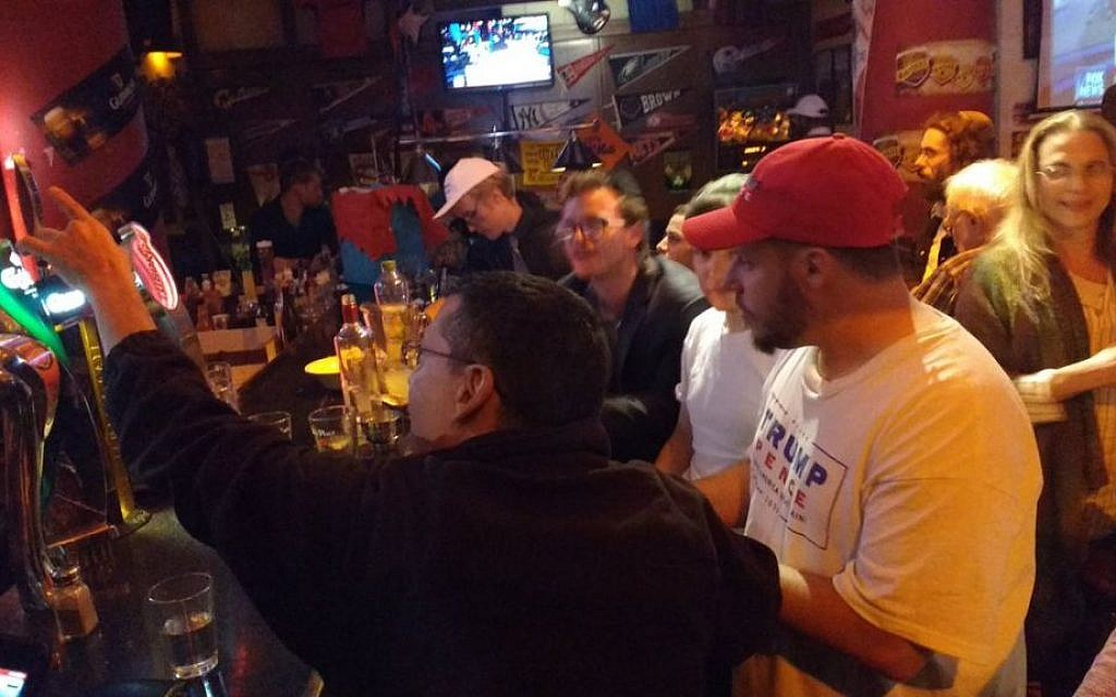 Trump supporters at Mike's Place bar in Jerusalem on November 9, 2016. (Melanie Lidman/ Times of Israel)