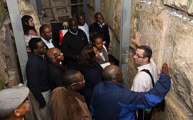 A group of African diplomat looking at the foundation stones of the Western Wall in Jerusalem, underneath the area known as Robinson's Arch, November 28, 2016 (Michel Rozili/City of David)