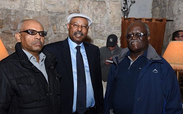From left to right: Ethiopian Ambassador to Israel Helawi Yossef, MK Avraham Negosa and Zambian Ambassador to Israel Martin Mwanambale, in a restaurant near the Western Wall in Jerusalem, November 20, 2016 (Michel Rozili/City of David)