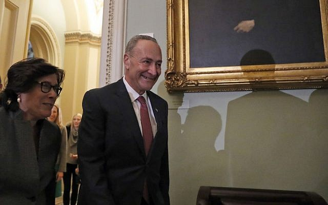 Senator Charles Schumer (D-NY) arrives for a Senate Democratic caucus organizing meeting to elect their leadership for the 115th Congress, Wednesday, November 16, 2016, on Capitol Hill in Washington. (AP Photo/Alex Brandon)