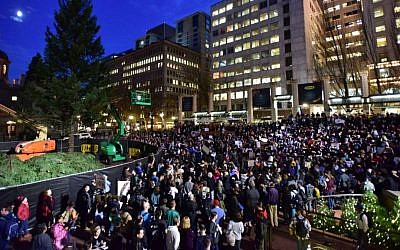 Protesters gather in Pioneer Courthouse Square in Portland, Oregon, the third night of protests over the results of the 2016 US presidential election, Thursday, Nov. 10, 2016. (Mark Graves/The Oregonian/OregonLive.com via AP)