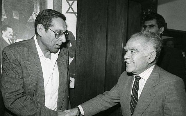 AN undated photo of Rehavam Zeevi shaking hands with former prime minister Yizhak Shamir. (Moshe Shai/Flash90)