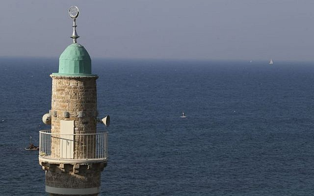 A minaret with loudspeakers seen towering over the Mediterranean sea, near the Israeli town of Tel Aviv-Jaffo, November 15, 2014. (Nati SHohat/FLASH90)