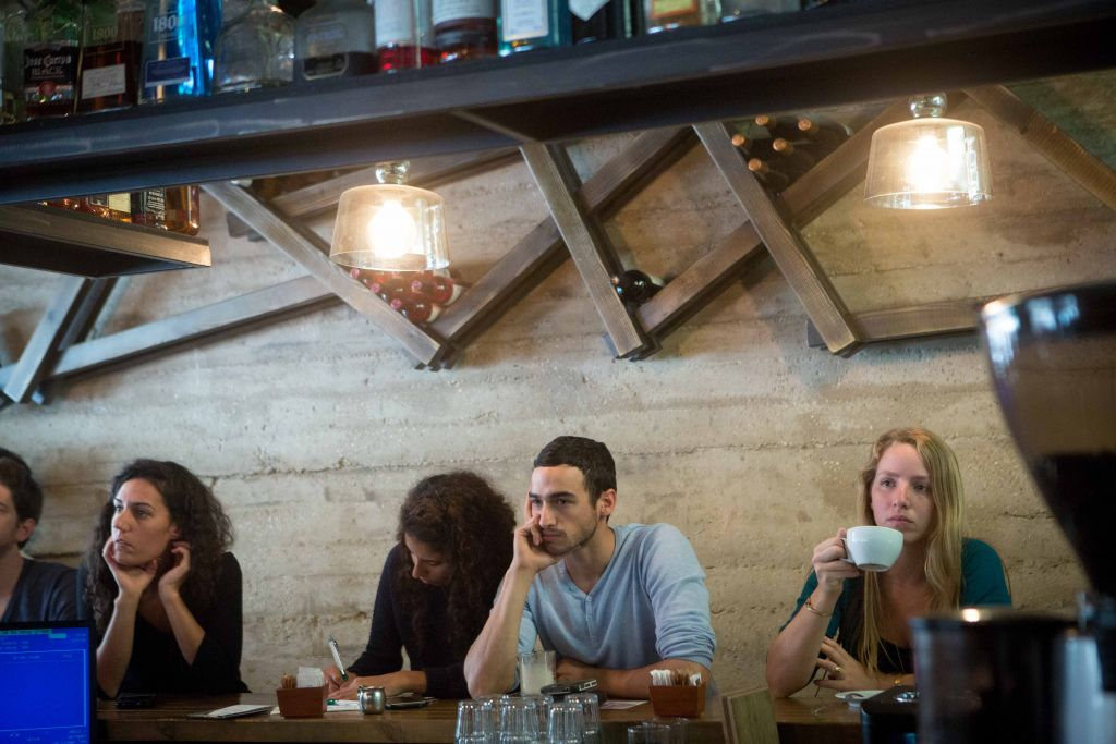 Hanging out in cafes is an elemental part of Israeli and Jerusalem culture, and one that can't really happen on Shabbat (Miriam Alster/Flash 90)