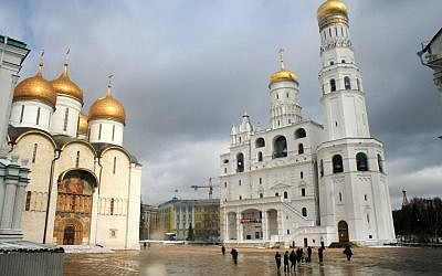 Visitors seen walking by the large cathedrals in the Kremlin, in Moscow, Russia, March 13, 2012. (Moshe Shai/Flash90)