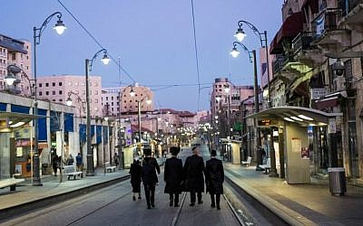 Illustrative photo of Orthodox Jews walking on a street in Jerusalem during  Shabbat. (Corinna Kern/Flash 90)