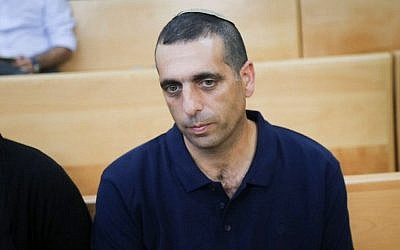 Ofek Buchris, the former military brigadier general accused of rape and other sexual crimes against subordinates, seen at the Jaffa military court on September 29, 2016. (Flash90)