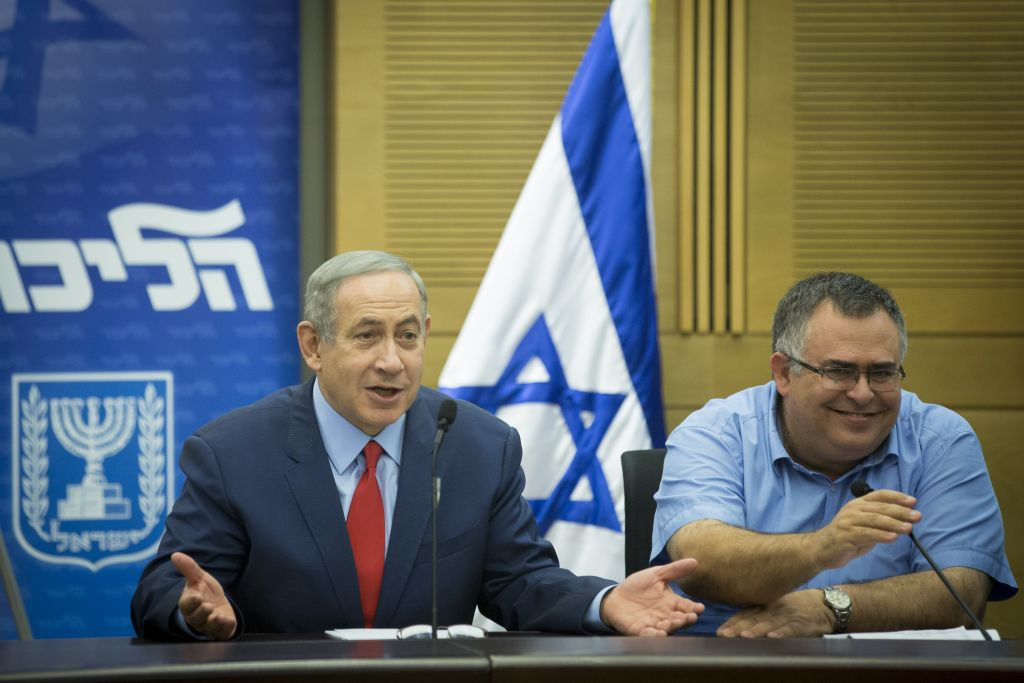 Prime Minister Benjamin Netanyahu (left) and MK David Bitan attend a Likud faction meeting in the Knesset, October 31, 2016. (Miriam Alster/FLASH90)