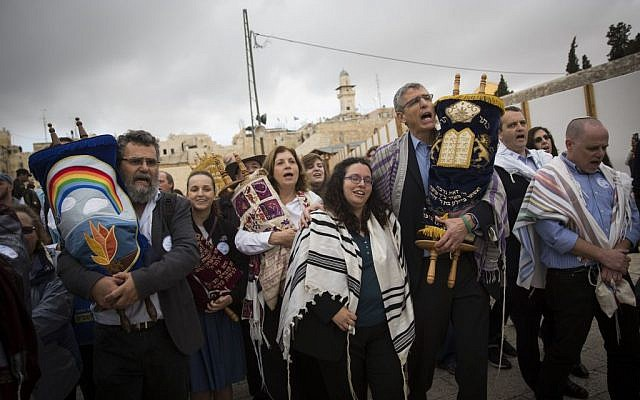 A group of American Conservative and Reform rabbis and members of the Women of the Wall carry Torah scrolls during a protest march against the government's failure to deliver a new prayer space, at the Western Wall in Jerusalem's Old City, November 2, 2016. (Hadas Parush/Flash90)