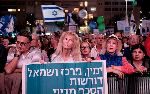Israelis attend a rally marking 21 years since the assassination of Yitzhak Rabin at Rabin Square in Tel Aviv on November 5, 2016. The banner reads: 'Right, center and left demand a diplomatic agreement' (Photo by Tomer Neuberg/Flash90)