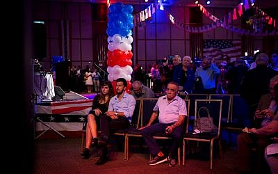 People watch elections results at a US presidential elections event organized by the US Embassy in Tel Aviv, on November 8, 2016. (Miriam Alster/Flash90)