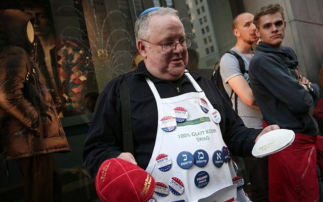 A supporter of Donald Trump with pins bearing his name in Hebrew, outside the Trump Tower in New York City, USA, on November 8, 2016. (Noam Revkin FentonFlash90)