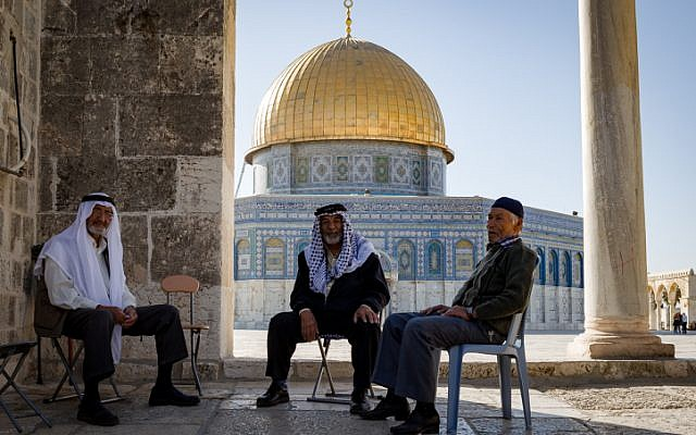 Three Arab men in front the Dome of the Rock seen on the al-Aqsa Mosque compound in the Old City of Jerusalem, on November 08, 2016. (Sebi Berens/Flash90)