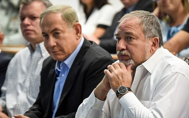 Prime Minister Benjamin Netanyahu, left, and then-Defense Minister Avigdor Liberman attend the opening ceremony of the Bahadim IDF Training Bases City in southern Israel, November 15, 2016. (Haim Bornstein/Pool)