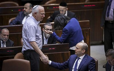 Jewish Home leader Naftali Bennett (sitting) with Jewish Home MK Uri Ariel during a plenum session on the so-called Regulation Bill, November 16, 2016. (Yonatan Sindel/Flash90)