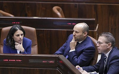 Jewish Home leader Education Minister Naftali Bennett, center, with fellow Jewish Home lawmaker Justice Minister Ayelet Shaked, right, and Public Security Minister Gilad Erdan during a plenum vote on the Regulation Bill on November 16, 2016. (Yonatan Sindel/Flash90)