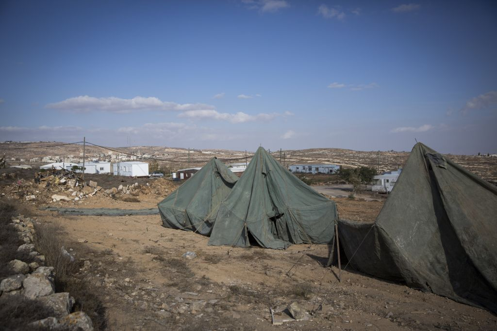 Tents being set up near caravan homes at the unauthorized Israeli outpost of Amona, in the West Bank, on November 17, 2016. (Miriam Alster/Flash90)