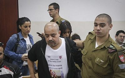 Elior Azaria seen with his father, left, during a court hearing at a military court in Jaffa, November 23, 2016. (Flash90)