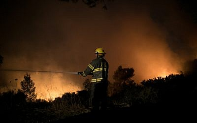 Illustrative: Firefighters battle a wildfire near Nataf, outside of Jerusalem, on November 25, 2016. (Yonatan Sindel/Flash90)