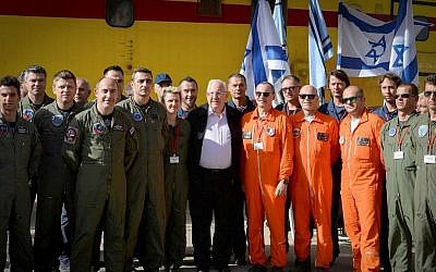Israeli president Reuven Rivlin meets with firefighter pilots in Nataf, outside of Jerusalem, which was damaged in a major fire a few days ago. November 27, 2016. (Mark Neyman/GPO via Flash 90)