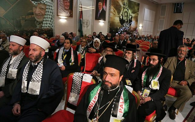 Members of the Neturei Karta sit alongside Muslim Imams at the opening ceremony of the 7th Fatah Congress on November 29, 2016, in the West Bank city of Ramallah. (Credit: Flash90 )