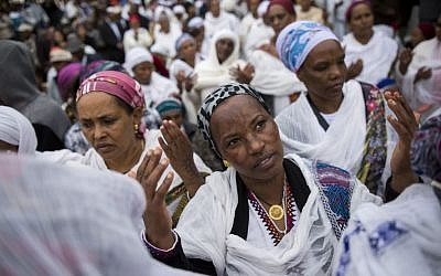 Illustrative: Ethiopian Israelis take part in a prayer service for the Sigd holiday on the Armon Hanatziv Promenade in Jerusalem on November 30, 2016. (Photo by Miriam Alster/Flash90)