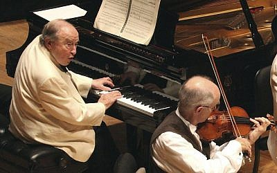 In this Aug. 20, 2013 photo provided by the Boston Symphony Orchestra, Pianist Menahem Pressler, left, performs with Boston Symphony Chamber Players at Tanglewood in Stockbridge, Mass. Pressler. (Hilary Scott/Boston Symphony Orchestra via AP)