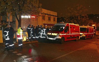 Firefighters and ambulances are seen in the village of Montferrier-sur-Lez, southern France, Friday, Nov. 25, 2016. The French gendarmerie says a masked gunman burst into a retirement home for monks and killed an elderly woman with a knife there. (AP Photo)