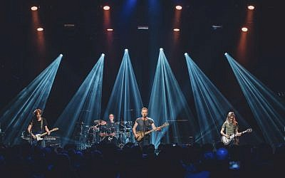 In this Saturday, November 12, 2016 photo provided by Universal Music France, British musician Sting, center, performs on stage at the reopened Bataclan concert hall in Paris, France, Saturday, November 12, 2016. (Boris Allin/Universal Music France via AP)