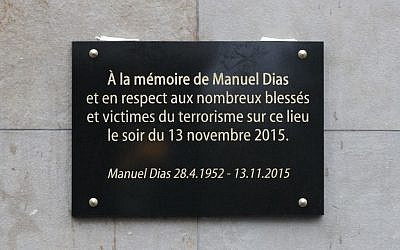 A commemorative plaque unveiled by French President Francois Hollande and Saint-Denis Mayor Didier Paillard is seen outside the Stade de France stadium, in Saint-Denis, near Paris, France, Sunday, November 13 2016. The plaque reads : In memory of Manuel Dias and in respect of the numerous wounded and victims of the terrorism. (Philippe Wojazer/Pool Photo via AP)