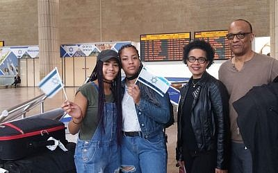 Amy and George Camara and two of their four children arriving in Israel, Nov. 2, 2016. (JTA/ Courtesy of the International Fellowship of Christians and Jews)