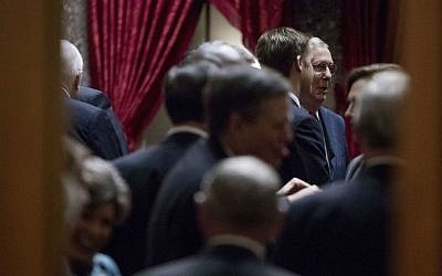Senate Majority Leader Mitch McConnell of Kentucky, right, speaks with other Senators before a Senate Republican conference leadership election meeting on Capitol Hill in Washington, Wednesday, Nov. 16, 2016. (AP Photo/Andrew Harnik)