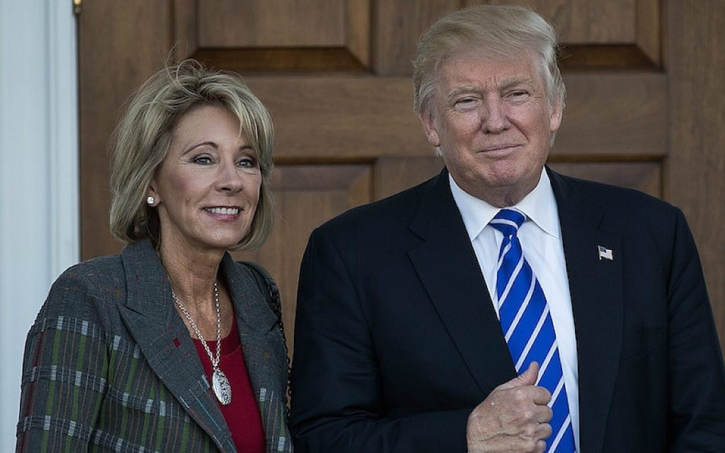 Betsy DeVos and President-elect Donald Trump outside the clubhouse at Trump International Golf Club in Bedminster Township, New Jersey, Nov. 19, 2016. (Drew Angerer/Getty Images via JTA)
